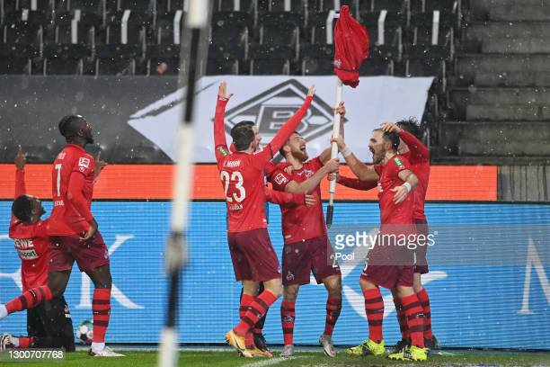 Players of 1.FC Koeln celebrate following their side's victory in the Bundesliga match between Borussia Moenchengladbach and 1. FC Koeln at...