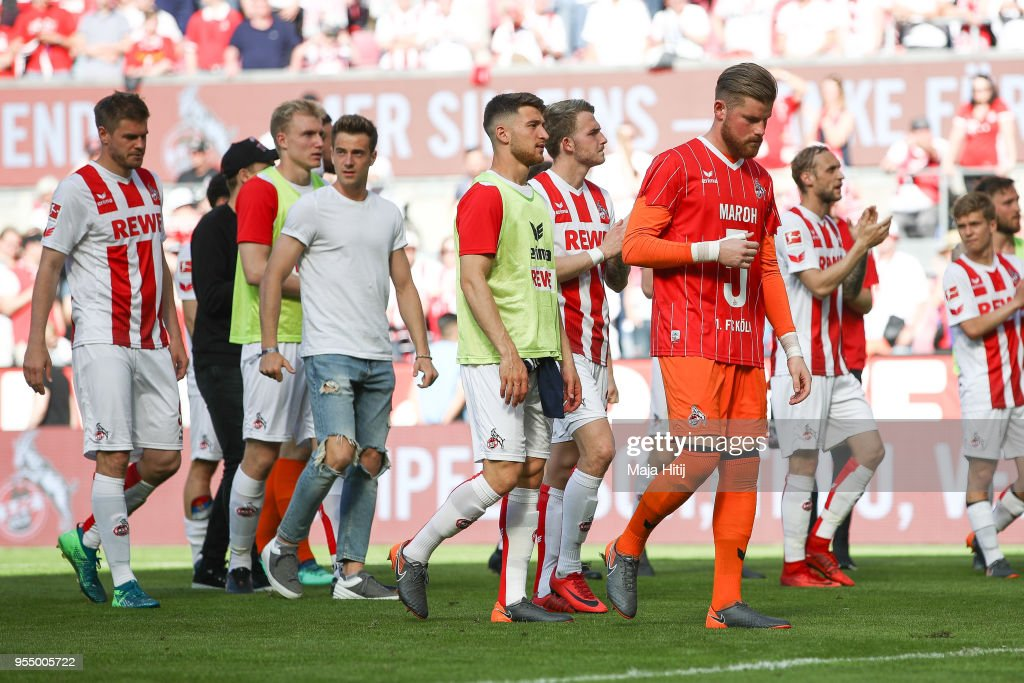 Players of 1.FC Koeln react after the Bundesliga match between 1. FC Koeln and FC Bayern Muenchen at RheinEnergieStadion on May 5, 2018 in Cologne, Germany.