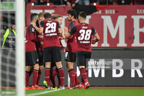 Players of 1FC Nuernberg celebrate their teams first goal during the Second Bundesliga match between 1 FC Nuernberg and FC Ingolstadt 04 at...