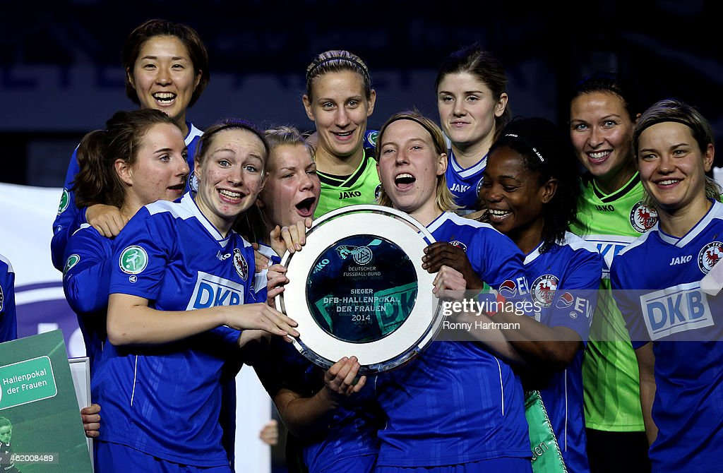 Players of 1.FFC Turbine Potsdam 1971 celebrate winning the DFB Women's Indoor Cup 2013 between 1.FFC Turbine Potsdam 1971 and 1. FFC Frankfurt during the DFB Women's Indoor Cup at GETEC-Arena on January 12, 2014 in Magdeburg, Germany.