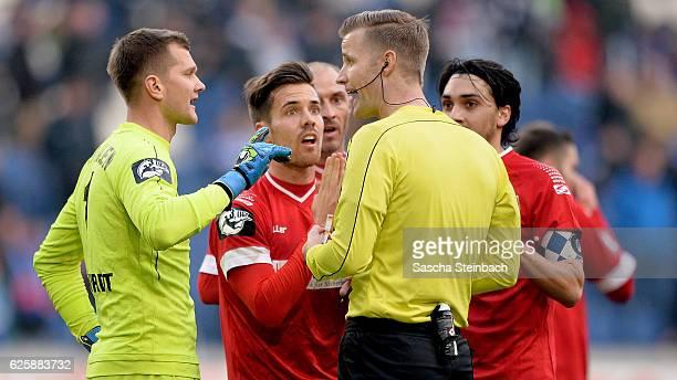 Players of Aalen protest at referee Arne Aarnink during the 3 Liga match between MSV Duisburg and VfR Aalen at SchauinslandReisenArena on November 26...