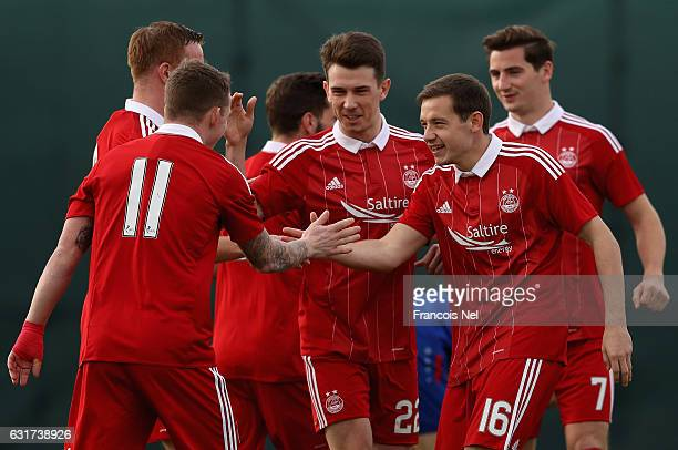 Players of Aberdeen FC celebrate the first goal during the friendly match between Aberdeen FC and FC Bunyodkor at the Jebel Ali Centre of Excellence...