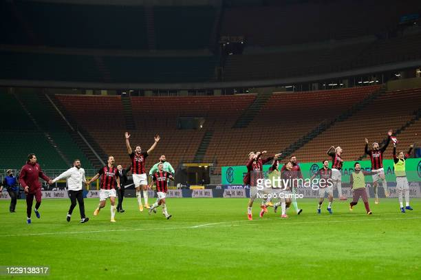 Players of AC Milan celebrate the victory at the end of the Serie A football match between FC Internazionale and AC Milan AC Milan won 21 over FC...
