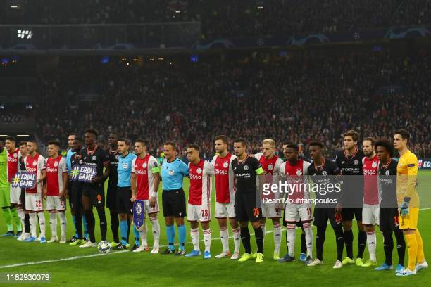 Players of AFC Ajax and Chelsea FC line up for a photograph prior to the UEFA Champions League group H match between AFC Ajax and Chelsea FC at...