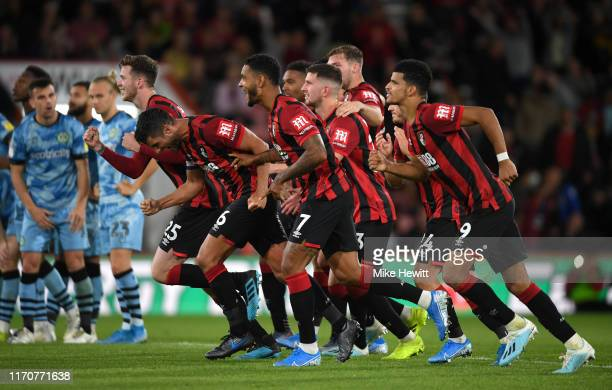 Players of AFC Bournemouth celebrate victory in the Carabao Cup Second Round match between AFC Bournemouth and Forest Green Rovers at Vitality...