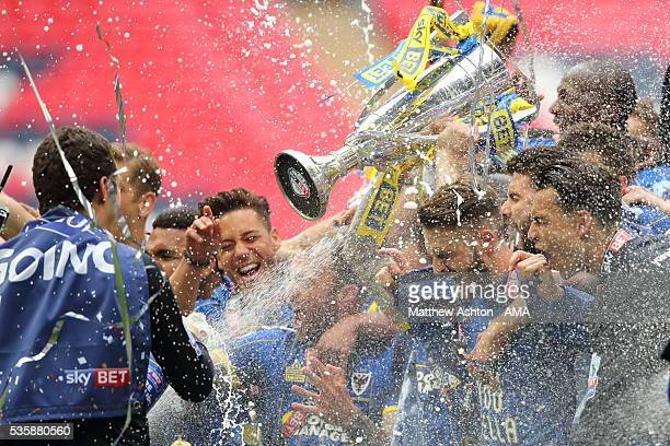 Players of AFC Wimbledon celebrate promotion after victory in the Sky Bet League Two Play Off Final between Plymouth Argyle and AFC Wimbledon at...