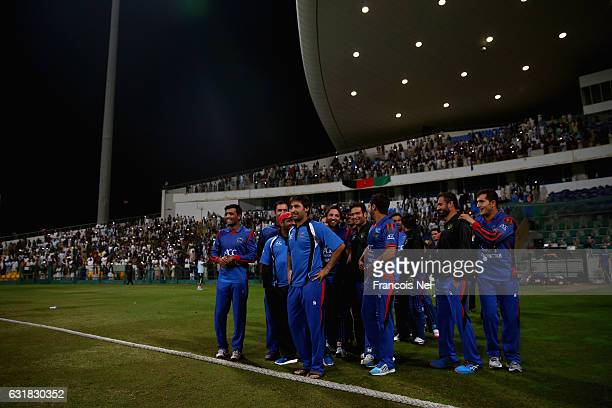 Players of Afghanistan celebrate after winning the Desert T20 Challenge match between Afghanistan and UAE at Sheikh Zayed Stadium on January 16 2017...