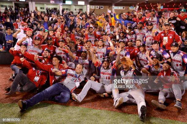 Players of Aguilas Cibaenas of Republica Dominicana celebrate their victory over Alazanes del Granma of Cuba in the Caribbean Baseball Series at the...