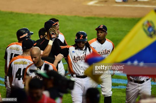 Players of Aguilas del Zulia from Venezuela celebrate after scoring against Alazanes de Granma from Cuba during the Caribbean Baseball Series at the...