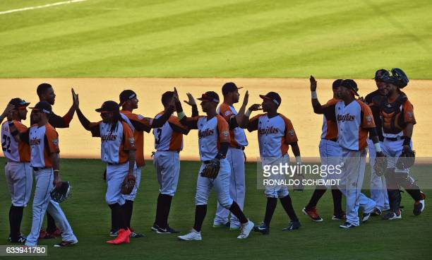 Players of Aguilas del Zulia of Venezuela celebrate winning the Caribbean Baseball Series match against Tigres del Licey of the Dominican Republic at...