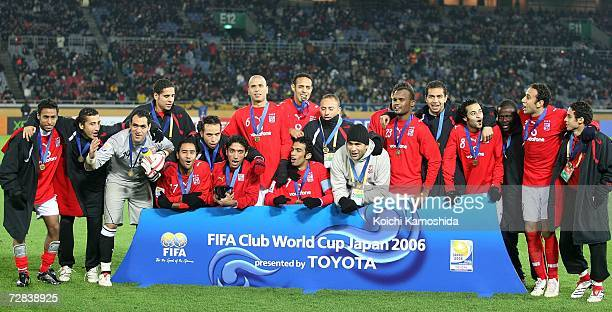 Players of Ahly Sporting Club celebrate after beating Club America by 2-1 during the FIFA Club World Cup Japan 2006 third place play-off match...