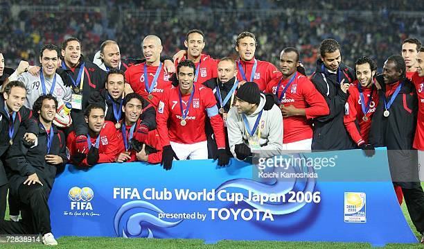 Players of Ahly Sporting Club celebrate after defeating Club America by 21 during the FIFA Club World Cup Japan 2006 third place playoff match...