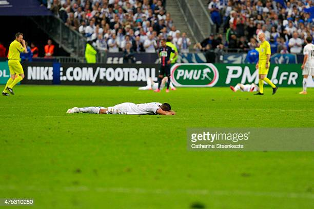 Players of AJ Auxerre lay down after the loss of the French Cup Final between AJ Auxerre and Paris SaintGermain at Stade de France on May 30 2015 in...