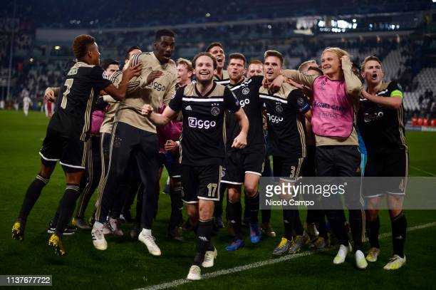 Players of Ajax Amsterdam celebrate the victory at the end of the UEFA Champions League Quarter Final second leg football match between Juventus FC...