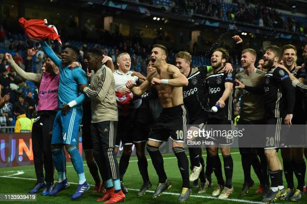 Players of Ajax celebrate the victory after the UEFA Champions League Round of 16 Second Leg match between Real Madrid and Ajax at Bernabeu on March...