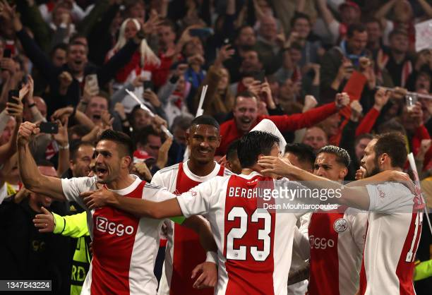Players of Ajax celebrate their side's first goal, an own goal by Marco Reus of Borussia Dortmund during the UEFA Champions League group C match...