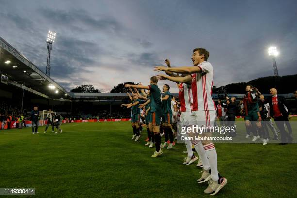 Players of Ajax celebrate winning the Eredivisie following the Eredivisie match between De Graafschap and Ajax at Stadion De Vijverberg on May 15...