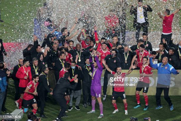 Players of Al Ahly celebrate with the trophy of CAF Champions League after winning the final match between Zamalek and Al Ahly at Cairo stadium on...