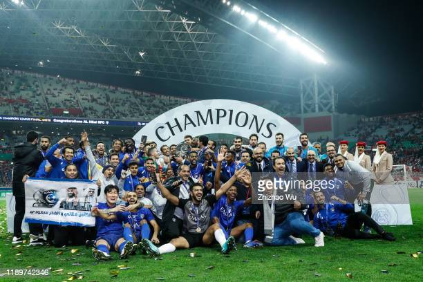 Players of Al Hilal celebrates the champion with the trophy after the AFC Champions League Final second leg match between Urawa Red Diamonds and Al...