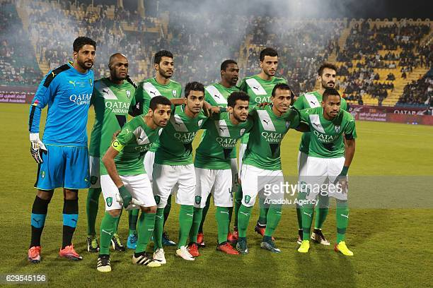 Players of Al-Ahli Saudi pose for a photo after a friendly soccer match between Al-Ahli Saudi and Barcelona at Al-Gharrafa Stadium in Doha, Qatar on...