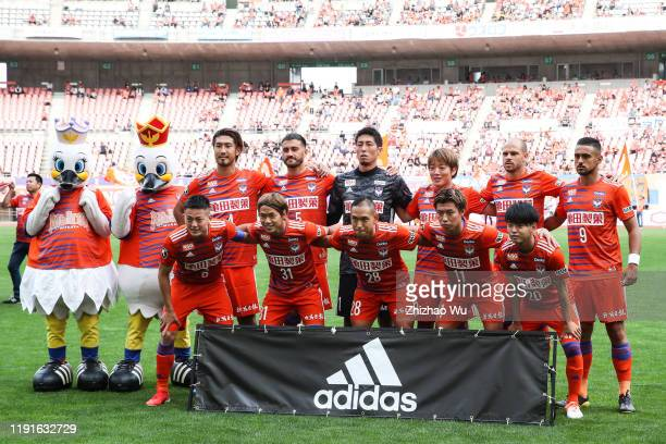 Players of Albirex Niigata line up for team photos prior to the J.League J2 match between Albirex Niigata v Kagoshima United at Denka Big Swan...