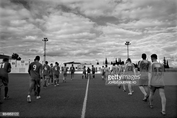 Players of Alma de Africa Union Deportiva and Espera CF arrive at the field for their football match in Espera on March 18 2018 / STORY 'Sporting...