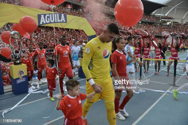Players of America and Junior enter field prior to the second leg final match of the Torneo Clausura Liga Aguila 2019 between America de Cali and...