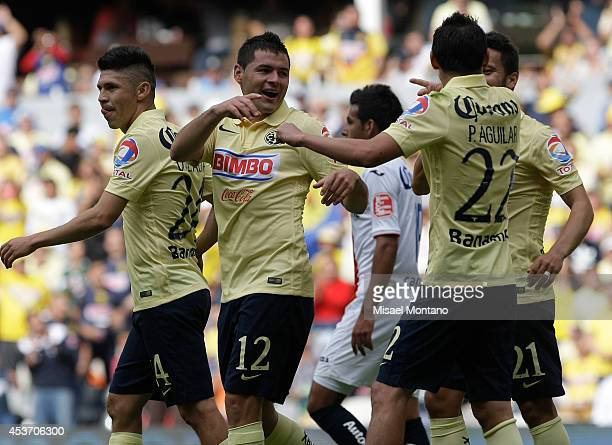 Players of America celebrate after scorng the first goal of the game during a match between America and Morelia as part of 5th round Apertura 2014...