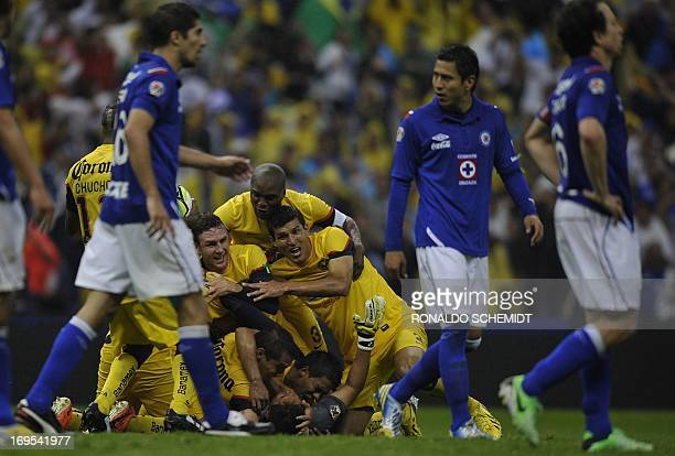 Players of America celebrate after winning the Mexican Clausura tournament final against Cruz Azul by penalty kicks at Azteca stadium in Mexico City...