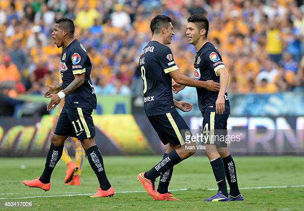 Players of America celebrate during a match between Tigres UANL and America as part of 4th round Apertura 2014 Liga MX at Universitario Stadium on...