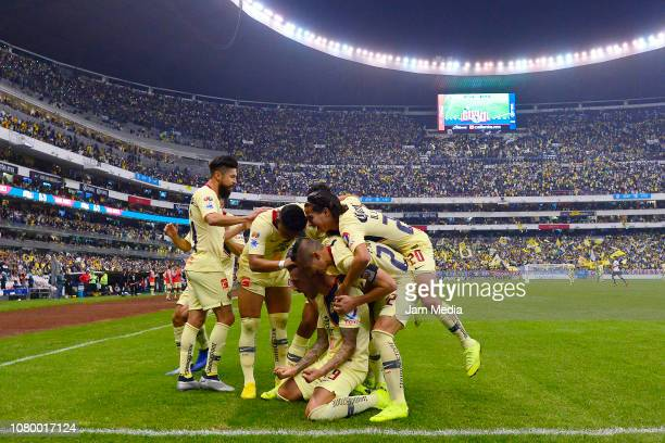 Players of America celebrate during the semifinal second leg match between America and Pumas UNAM as part of the Torneo Apertura 2018 Liga MX at...