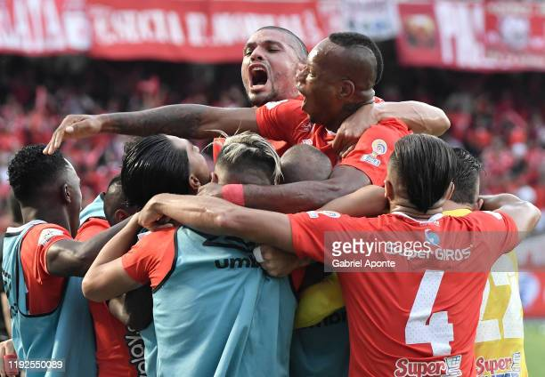 Players of America celebrate the first goal of their team scored by an own of of Sebastian Viera of Junior during the second leg final match of the...