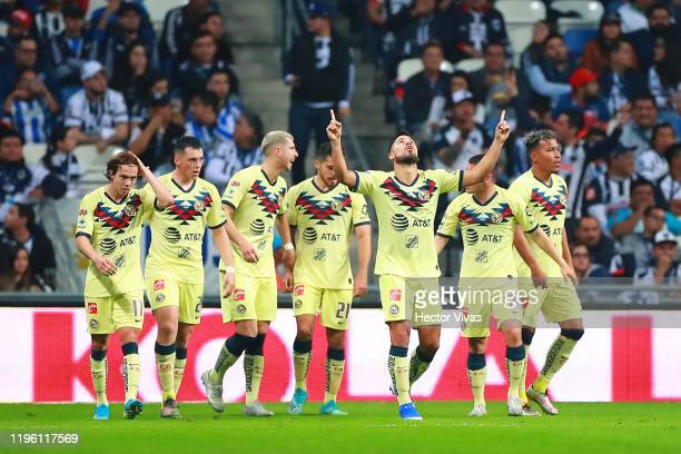 Players of America celebrate their first goal after an own goal by Carlos Rodriguez of Monterrey during the Final first leg match between Monterrey...