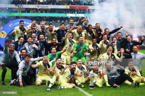 Players of America celebrate with the Championship Trophy after the final second leg match between Cruz Azul and America as part of the Torneo...