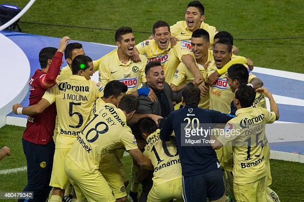 Players of America celebrate with their coach Antonio Mohamed after winning the Final second leg match between America and Tigres UANL as part of the...