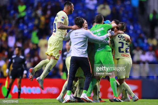 Players of America celebrates after winning the 10th round match between Puebla and America as part of the Torneo Apertura 2018 Liga MX at Cuauhtemoc...