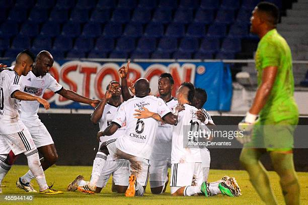 Players of America de Cali celebrate a scored goal by John Perez during a match between Barranquilla FC and America de Cali as part of 11th round of...