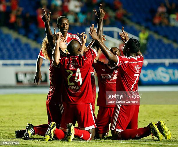 Players of America de Cali celebrate the first goal of his team scored goal by Oswaldo Blanco during a match between America de Cali and Santander as...