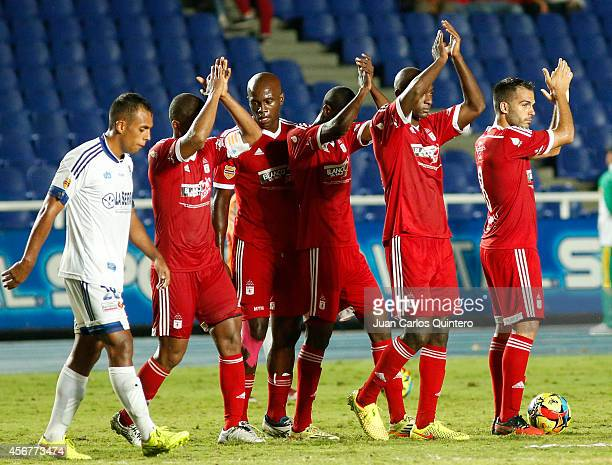 Players of America de Cali clap their hands after a match between America de Cali and Santander as part of 14th round of Torneo Postobon 2014 II at...