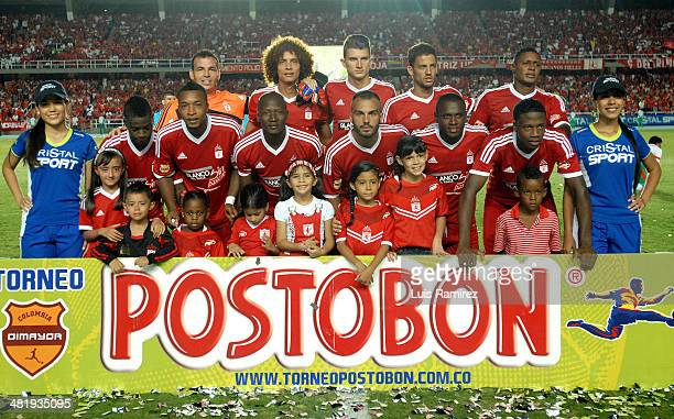 Players of America de Cali pose for a photo before a match between America de Cali and Barranquilla as part of Torneo Postobon 2014 at Pascual...