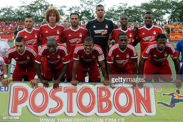 Players of America de Cali pose for a photo prior to a match between America de Cali and Llaneros FC as part of Torneo Postobon 2014 II at Manuel...
