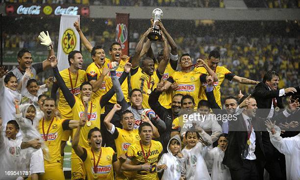 Players of America hold the Mexican Clausura Tournament trophy at the Azteca stadium after won the game against Cruz Azul by penalty kicks in Mexico...