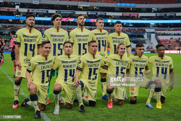 Players of America pose for the group photo wearing a jersey with number 15 to support Nicolas Castillo prior the 6th round match between America and...