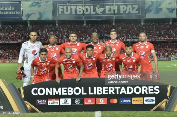 Players of America pose to a photo prior a Group E match between America de Cali and Gremio as part of Copa CONMEBOL Libertadores 2020 at Estadio...