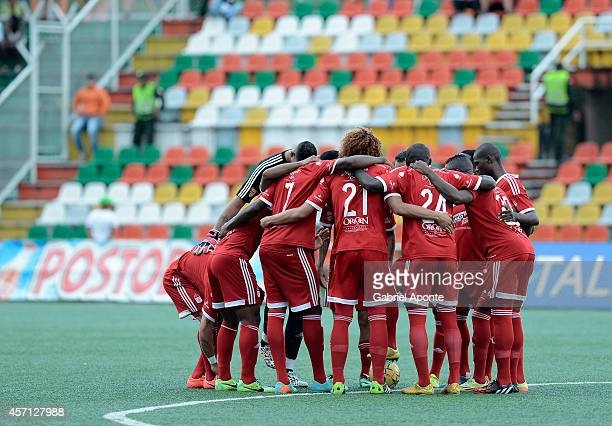 Players of America pray prior to a match between America de Cali and Llaneros FC as part of Torneo Postobon 2014 II at Manuel Calle Lombana Stadium...