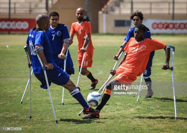 Players of amputee teams in action during the first Amputee football teams' soccer match that held by the International Committee of the Red Cross in...