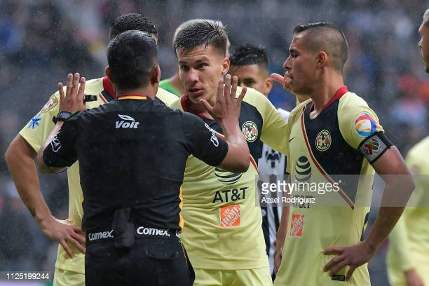 Players of América argue with referee Fernando guerrero during the 4th round match between Monterrey and America as part of the Torneo Clausura 2019...