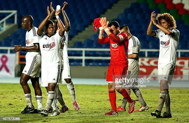 Players of América de Cali calp their hands after a match between Depor FC and America de Cali as part qof round 17 of Torneo Postobon II at Pascual...