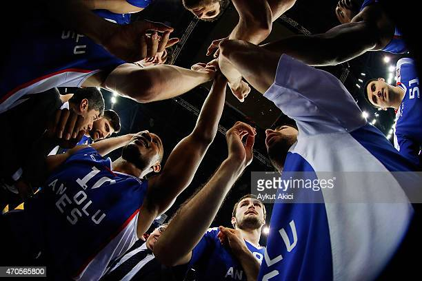 Players of Anadolu Efes Istanbul celebrate victory during the 2014-2015 Turkish Airlines Euroleague Basketball Play Off Game 3 between Anadolu Efes...