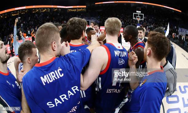 Players of Anadolu Efes Istanbul celebrate victory during the 2017/2018 Turkish Airlines EuroLeague Regular Season game between Anadolu Efes Istanbul...